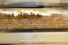 Freshly cut cigarettes make their way through a machine at Imperial Tobacco, Petone. Herald on Sunday Photograph by Hagen Hopkins