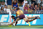 Former Cowboys star Curtis Rona scoring thier second try against the Brisbane Broncos in 2014. Photo / Richard Robinson