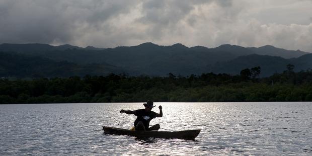 Loading A fisherman casts a line off the East Malaita coast near Ngongosila in the Solomon Islands. Photo / Mike Scott
