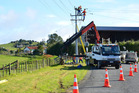 Top Energy staff repair a damaged power pole in Kaikohe. PHOTO / FILE