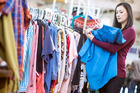 Cut your fashion spending by visiting second-hand stores. Photo / Getty Images
