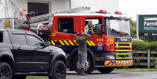 Firefighters attending a chemical spill at Farmlands Whakatu on Ruahapia Road this afternoon. Photo/ Paul Taylor.