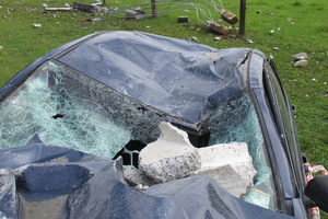 Several large pieces of rubble landed on the unoccupied passenger side of the vehicle.
