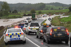 Traffic backed up for half a kilometre in both directions after the bottom of Bulls Gorge flooded, on State Highway 10 south of Kerikeri. PHOTO / PETER DE GRAAF