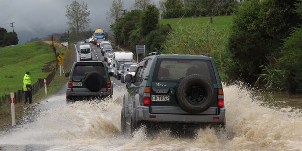 Traffic backed up for half a kilometre in both directions after the bottom of Bulls Gorge flooded, on State Highway 10 south of Kerikeri today. Photo/Peter de Graaf
