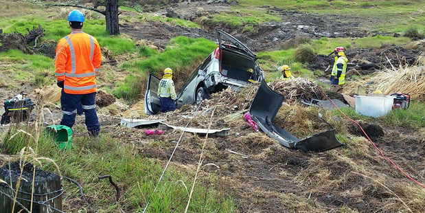 Firefighters used ropes tied to a strainer post to secure a vehicle that went off the road near Mangapai. Photo/ Supplied