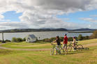 Cyclists at Mangungu Mission Station in South Hokianga, the end point of the Twin Coast Cycle Trail. The trail's last and most scenic section, from Okaihau to Horeke, will finally open on March 18.