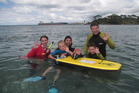 Snorkel guide Isabel Krauss with participants in the free family event.