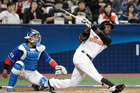 Netherlands's Jurickson Profar hits a two-run home against South Korea. Photo / Getty Images