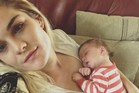 Aimee Balle and her eight-week-old baby. Balle has won $50,000 by guessing ZM's Secret Sound. Photo/ ZM