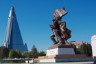 The Victorious Fatherland Liberation War Museum and the Ryugyong Hotel. Photo / Clay Gilliland