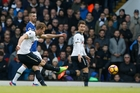 Harry Kane drills home the opener for Spurs against Everton yesterday. Photo / AP