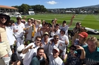In fine voice ... university students take a day off lectures to soak up the atmosphere at the Dunedin Village Green. Photo / Supplied
