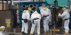 Workers wearing protective gears are seen at the tsunami-crippled Fukushima Dai-ichi nuclear power plant. Photo / AP
