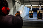 Stephen Yorkman, president of the Prince George's County chapter of the National African American Gun Association, fires a 9mm handgun at the Maryland Small Arms Range. Photo / The Washington Post