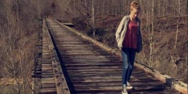 Libby German uploaded this haunting photograph of Abby walking along the old railroad bridge, at Delphi Historic Trails shortly before the pair were kidnapped and murdered. Photo / Snapchat