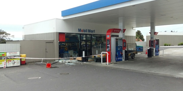 The forecourt of a North Shore petrol station is cordoned off after an overnight ram raid. Photo / Supplied