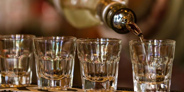 The man bet a group at a nightclub that he could down a whole bottle of tequila. Photo / 123rf