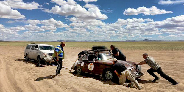 The couple's Porsche gets stuck in the sand in Zavkhan Province, Mongolia. Photo / Jill Kirkpatrick