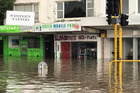 Flooding on Clark St in Auckland's New Lynn yesterday. Photo / Nadia Tolich