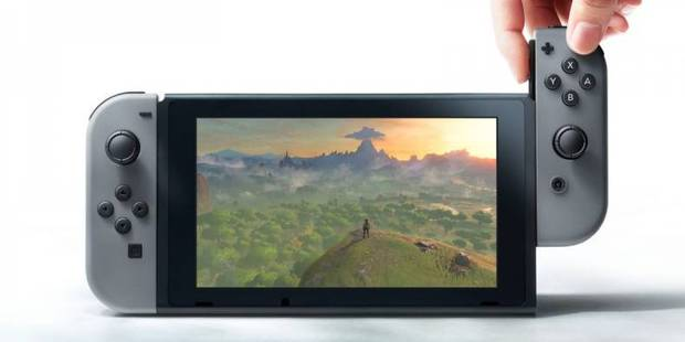 The Nintendo Switch in portable mode. The controllers slide onto the side of the tablet.