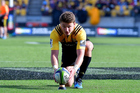 Beauden Barrett of the Hurricanes sets up a kick during his side's game against the Rebels. Photosport