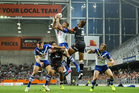 Marcelo Montoya of the Bulldogs leaps to take a ball over Manu Vatuvei. Photo / photosport.nz