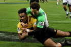Hurricanes' Julian Savea scores a try as he is tackled by Highlanders' Marty Banks. Photosport
