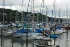 Boaties attempt to stop a yacht sinking at its mooring at Whangarei's Town Basin Marina today.