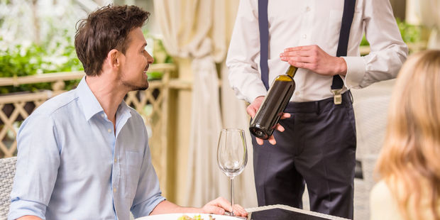 Restaurants know diners will often choose the second or third cheapest wine on the list - and place wines with a high mark up in these slots on purpose. Photo / 123RF