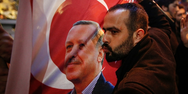 A protester kisses an image of President Recep Tayyip Erdogan during a demonstration outside the Dutch consulate in Istanbul. Photo / AP