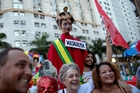 Brazilians, saddled with a sickly economy, carry an effigy of impeached President Dilma Roussef. Photo / AP