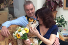 Mili the dog 12, lovingly watched on as owner Nicole Wakefield, 56, got hitched to long term partner Arfon Williams, 61. Photo / Caters