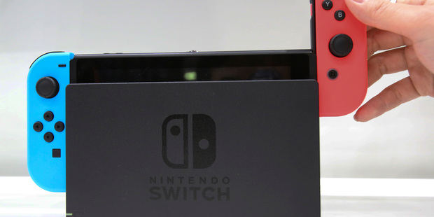 Sliding JoyCon controllers off the docked Switch