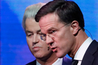 Right-wing populist leader Geert Wilders and Dutch Prime Minister Mark Rutte, right, leave the stage after a national televised debate. Photo / AP