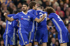 Chelsea's Diego Costa celebrates with his teammates after N'Golo Kante scored a goal. Photo / AP
