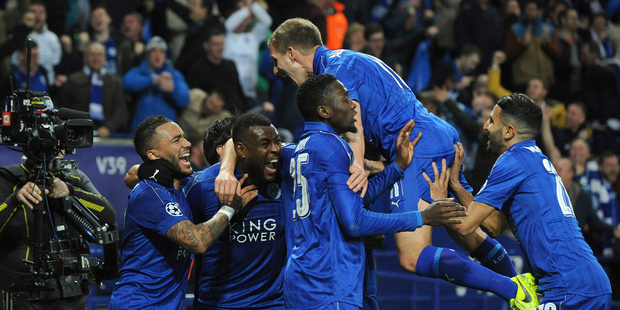 Leicester's Wes Morgan, second left, celebrates with team mates after he scored a goal. photo / AP