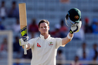 Australia's captain Steven Smith raises his bat and helmet to celebrate scoring a century. Photo / AP