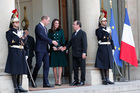 French President Francois Hollande, center right, shakes hands with Prince William and Kate, Duchess of Cambridge after their meeting at the Elysee Palace in Paris. Photo / AP