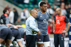 England's head coach Eddie Jones speaks to England's Nathan Hughes as his players warm-up before the Six Nations rugby union international between England and Scotland. Photo / AP