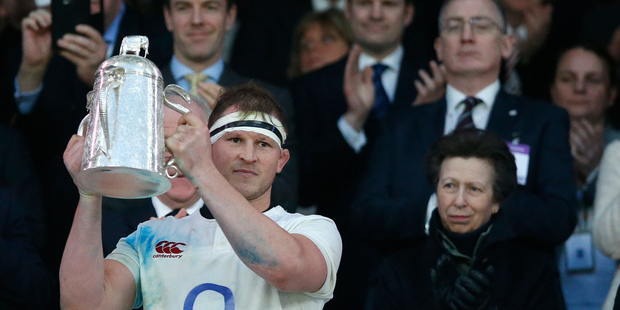 England's Dylan Hartley holds up the Calcutta Cup. Photo / AP
