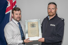 Detective Ben Hurley (left) and Daniel Lumby hold the war scroll, which Hurley has been trying to return to the family for a year. Photo/supplied