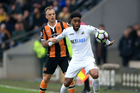 Hull City's Kamil Grosicki and Swansea City's Leroy Fer compete for the ball. Photo / AP.