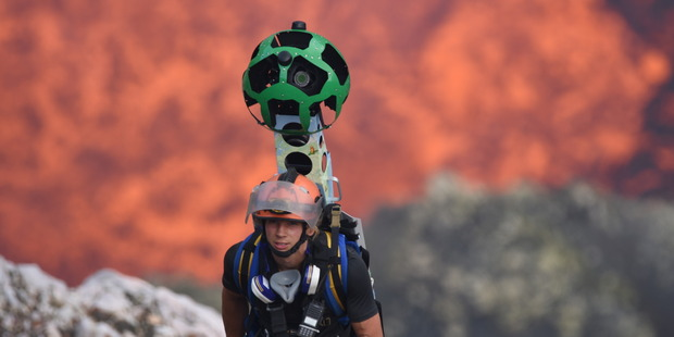 Loading Chris Horsly descends into the volcano with the Google Street View Trekker. Photo/Google