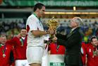 Martin Johnson receives the Webb Ellis Trophy from Australian Prime Minister in 2003. Photosport