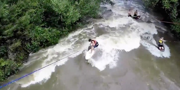 Footage of the stunt shows a group of 15 young men surfing a swollen Rangitopuni Stream in Riverhead, north-west Auckland.