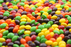 There's a reason it feels like red Skittles are hard to come by. Photo / Getty