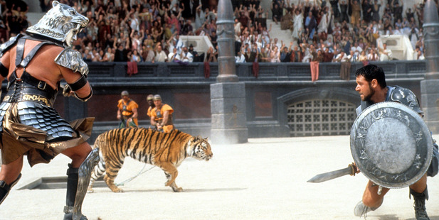 Russell Crowe facing off against tiger in a scene from the film 'Gladiator', 2000. Photo / Getty
