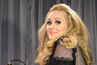 Adele is good at telling her own secrets. Photo / Getty