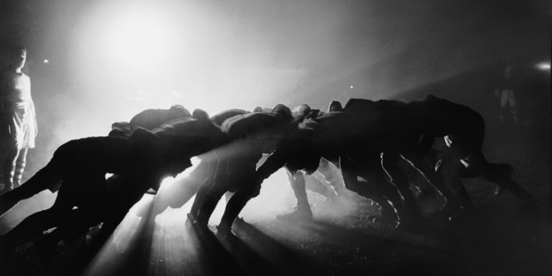 Loading Players in a scrum during a rugby match are silhouetted by floodlights. Photo / Getty
